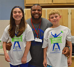 Former NFL Legend Damina Gregory supports the Calais Foundation - shown with students