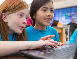 Two students working on a Microsoft Surface during Calais Week at Microsoft